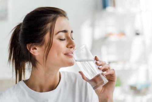 woman drinking vadiance and rebalancing vital lifeforce energies